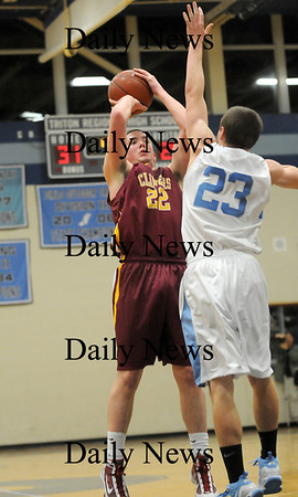 Byfield: Newburyport captain, Nick Welch (22) shoots over an outstreched Mike Foley (23) of Triton during Tuesday nights game in Byfield. Photo by Ben Laing/Staff Photo