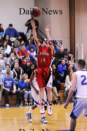 Georgetown: Amesbury's James Parady (14) releases a jump shot during Monday nights game against Georgetown. The two teams faced off in the second game of a double header as part of the inaugrual River Rivals Basketball Festival. Photo by Ben Laing/Staff Photo