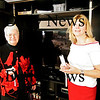 Salisbury: Priscilla Kime, left, and Salisbury's Director for the Council on Aging, Elizabeth Pettis, right, stand in front a new television set with Wii remotes in hand at the Hilton Center in Salisbury. The tv and Wii were donated after a recent theft at the Center. Photo by Ben Laing/Staff Photo