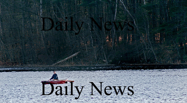 Amesbury: A man in a red rowboat glides across the Merrimack River, heading from Amesbury towards Maudslay State Park in Newburyport. Photo by Ben Laing/Staff Photo