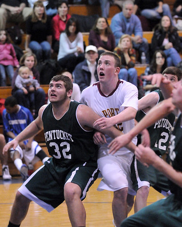 Georgetown: Pentucket's Cameron Spofford (32) boxes out Newburyport's Nick Welch (22) for a rebound during Monday night's opening game of the inaugural River Rival Basketball Festival at Georgetown High. Photo by Ben Laing/Staff Photo