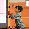 Salisbury: Ryan Freeman, 6, of Salisbury, shoots some hoops Monday afternoon while at the Boys and Girls Club in Salisbury. Photo by Ben Laing/Staff Photo