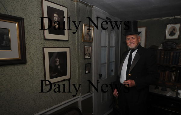 Amesbury: Nick Costello dressed the part as poet John Greenleaf Whittier atthe Holiday Open House at the Whittier Home on Friend Street in Amesbury Sunday afternoon. Jim Vaiknoras/Staff photo