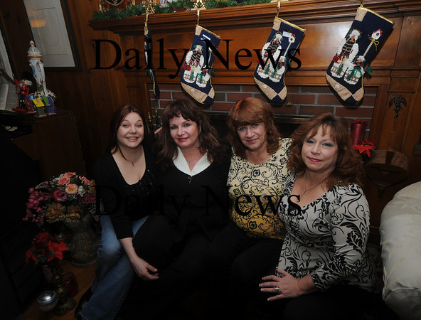 Merrimac: From the left;Long lost sisters Patricia Eaton, Missie Lucero, Susan Romley Moranz, and Nicki Alonzo, at the Eaton home in Merrimac. Jim Vaiknoras/Staff photo