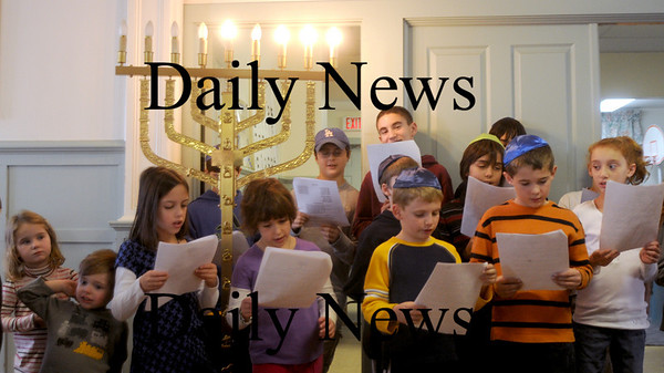 Newburyport: Children sing blessings at the  annual Chanukah breakfast at the Congregation Ahavas Achim in Newburyport Sunday morning.. Jim Vaiknoras/Staff photo