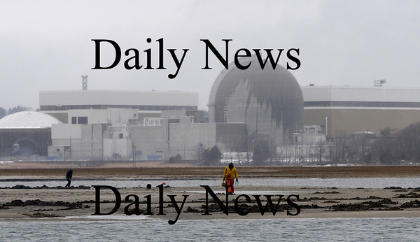Seabrook: Clammers dig at low tide in Seabrook Harbor in the shadow of the power plant Saturday afternoon.Jim Vaiknoras/Staff photo