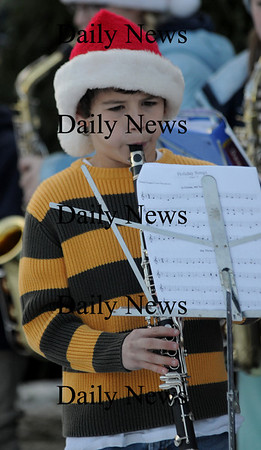 ewbury: Ben Hall plays carols on the clarinet with the Newbury Emementary School Band at the Newbury Tree Lighting on the Upper Green Sunday. Jim Vaiknoras/Staff photo
