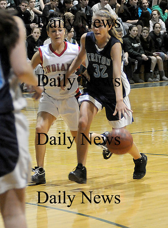 West Newbury: Triton's Jen Rock drives past Amesbury's Kerri Salvatore during their game Friday night at the River Rival Tournanment at Pentucket. Jim Vaiknoras/Staff photo