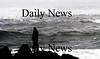 Newbury: A lone man watches the surf off Plum Island Sunday afternoon. Jim Vaiknoras/Staff photo