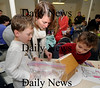Newburyport: Missy McLoy works on her gingerbread house with her kids Riley, 7, and Colin, 5 at the Old South Church in Newburyport. Jim Vaiknoras/Staff photo
