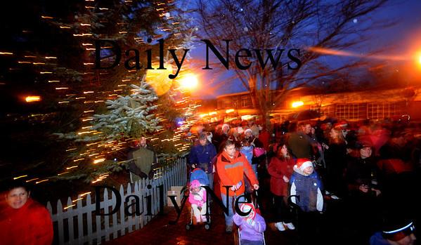 Amesbury: People gather around the newly lit Christmas Tree in Amesbury Square, following the annual Santa Parade. Jim vaiknoras/Staff photo