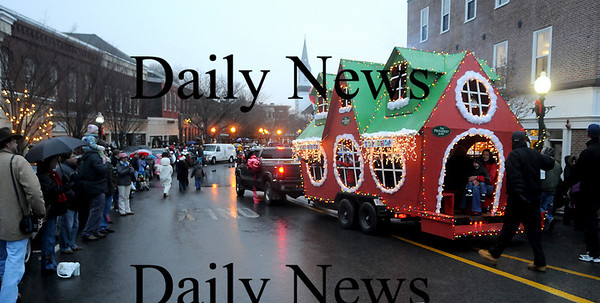 Amesbury: The float from the Provident Bank makes it's way through  Amesbury Square  at the annual Santa Parade. Jim vaiknoras/Staff photo