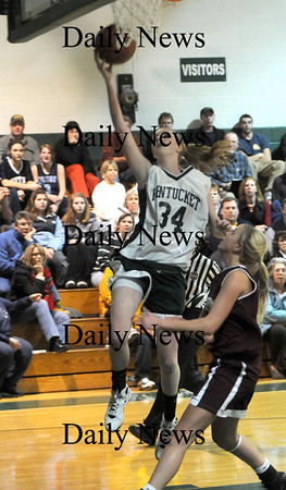 West Newbury: Pentucket's Vanessa Cahill drive to the basket for two during their game against Newburyport Friday night at the River Rival Tournanment at Pentucket. Jim Vaiknoras/Staff photo