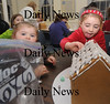 Newburyport: Shaelin Lombard 4 and her sister Riley, 2, work on theirgingerbread house at the Old South Church in Newburyport. Jim Vaiknoras/Staff photo
