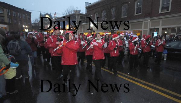 Amesbury: The Amesbury high marching band makes his way through  Amesbury Square  at the annual Santa Parade. Jim vaiknoras/Staff photo