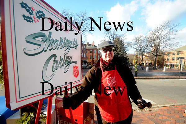 Newburyport: Chuck Bolton of Newburyport braves the cold Friday to ring the bell for the Salvation Army on the corner of Liberty and State Street in Newburyport. Jim Vaiknoras/Staff photo