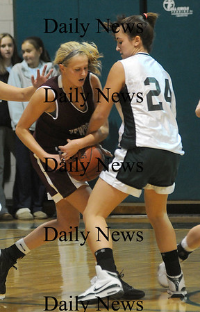 West Newbury: Pentucket's Ashley Viselli fights for the ball with Newburyport's Lindsey Tomasz  during their game Friday night at the River Rival Tournanment at Pentucket. Jim Vaiknoras/Staff photo