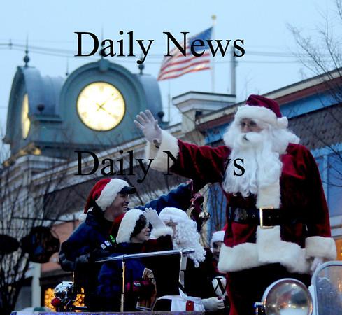 Amesbury: Santa waves to the crowd as he makes his way through  Amesbury Square  at the annual Santa Parade. Jim vaiknoras/Staff photo