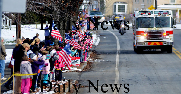 Rowley: Students at the Pine Grove School in Rowley line Main Street to greet Wreaths Across America as it makes it's way  from Maine to Arlington Cemetary in Washington. Jim Vaiknoras/Staff photo