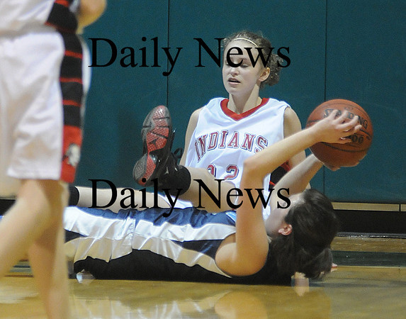 West Newbury: Amesbury's Delane Zahoruiko falls over Triton's Lauren Mihalchik during their game Friday night at the River Rival Tournanment at Pentucket. Jim Vaiknoras/Staff photo