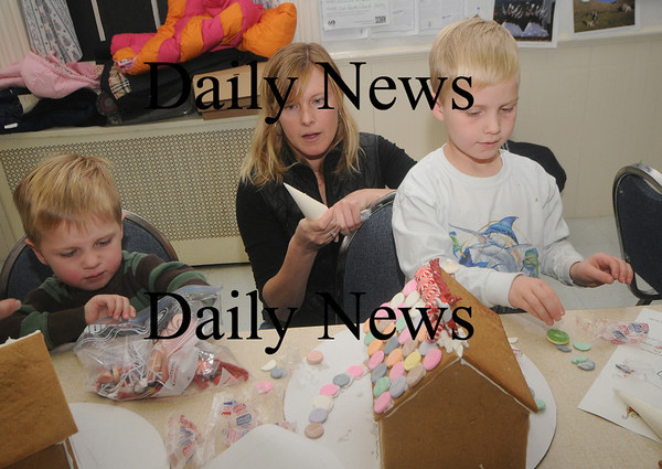 Newburyport: SJoy Cowles and her sons Tyler, 5, and Parker, 3, work on their gingerbread house at the Old South Church in Newburyport. Jim Vaiknoras/Staff photo