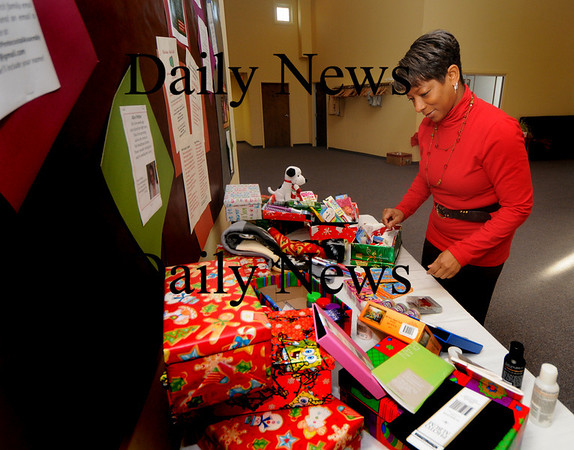 Newburyport: Kathleen Bailey puts together a Christmas Shoebox at the Newburyport Pentacostal Assembly in Newburyport. The gift filled boxes will benefit The Family Connection Health and Educational Services and The Council on Aging. Jim vaiknoras/Staff photo