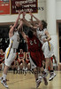Newburyport: Newburyport's Nicholas Welch and Kyle Uhig battle Amesbury's Ian McLaughlin for a rebound  at Newburyport Friday night. Jim Vaiknoras/Staff photo