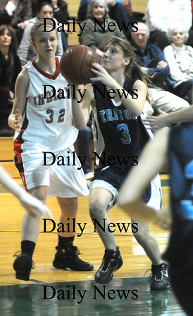 West Newbury: Triton's Alyssa Conley drives to the hoop against  drives  Amesbury's Delane Zahoruiko during their game Friday night at the River Rival Tournanment at Pentucket. Jim Vaiknoras/Staff photo
