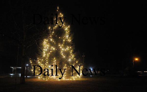 Salisbury: The Salisbury Christmas Tree illuminates the SQuare Sunday night. Jim Vaiknoras/Staff photo