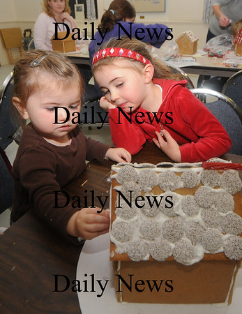 Newburyport: Shaelin Lombard 4 and her sister Riley 2 work on theirgingerbread house at the Old South Church in Newburyport. Jim Vaiknoras/Staff photo