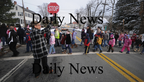 Rowley: Principal Christine Kneeland crosses students at the Pine Grove School in Rowley  as the prepare to line Main Street to greet Wreaths Across America as it makes it's way  from Maine to Arlington Cemetary in Washington. Jim Vaiknoras/Staff photo