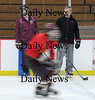 Newburyport: Jeff Wile stand with Newburyport hockey coach Paul Yameen. Wile a senior captain on the Newburyport golf team this past fall, had to give up nearly all competitive varsity sports three years ago during his freshman year when he was diagnosed with hypertrophic cardiomyopathy from an EKG after a routine checkup discovered a heart murmur. Wile now acts as essentially another coach for Paul Yameen on the hockey team.Jim Vaiknoras/Staff photo