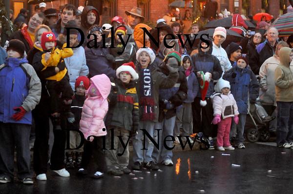 Amesbury:The crowd greets Santa as he makes his way through  Amesbury Square  at the annual Santa Parade. Jim vaiknoras/Staff photo