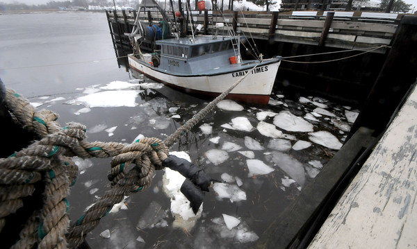 Newburyport: The Early Times sits docked in the embayment in Market Landing Park Sunday in Newburyport. The warm weather has melted most of the ice, cold is expected to return later this week. Jim Vaiknoras/Staff photo