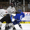 Newburyport: Newburyport's Zach Schmoeller (4) lays a big hit on Danvers' D.J. Yost (6) during Friday night's 6-0 Clipper victory. Photo by Ben Laing/Newburyport Daily News Friday February 20, 2009.