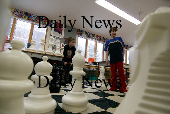 Amesbury: Sam Bullis (right) and Grant Quinn (left), both third grades at Amesbury Elementary, play with a life size chess. The pair are members of the after school chess club. Photo by Ben Laing/Newburyport Daily News Tuesday February 3, 2009.