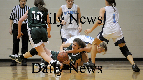 Byfield: Pentucket's Ashley Viselli (24) fights for a loose ball with Triton's Jen Rock (31) during Thursday night's game in Byfield. Photo by Ben Laing/Newburyport Daily News Thursday February 12, 2009.