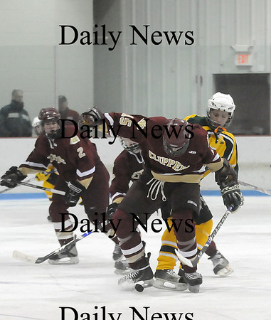 Reading: Newburyport's Corey Ruane (15) gets the puck tangled in his skates as he tries to break away from a North Reading opponent during Wednesday night's 5-1 road win. Photo by Ben Laing/Newburyport Daily News Wednesday February 11, 2009.