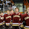 Salem: The Clippers stand together as the National Anthem plays prior to their 4-1 victory over Winthrop Friday night. Photo by Ben Laing/Newburyport Daily News Friday February 27, 2009.