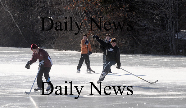 Newbury: A group of boys take advantage of school vacation to play some pond hockey on Hay Street in Newbury Monday afternoon. Photo by Ben Laing/Newburyport Daily News Monday February 16, 2009.