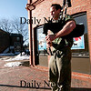 Newburyport: Jamie Douglas, one of the owners of the Black Dog, takes a break from renovating their space in downtown Newburyport to play his bagpipes Monday afternoon. Photo by Ben Laing/Newburyport Daily News Monday February 9, 2009.