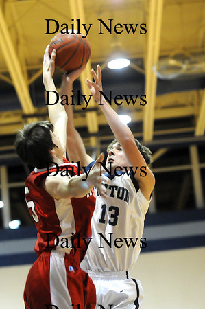 Byfield: Triton captain Collin Smith (13) has a shot blocked by Amesbury's Tyler Lay (15) during Thursday nights game in Byfield. Photo by Ben Laing/Newburyport Daily News Thursday February 5, 2009.