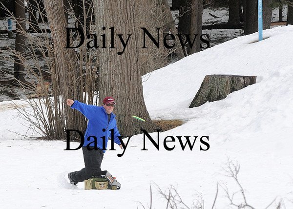 Amesbury: Mike Mason of New Hampshire plays a round of frisbee golf at the Amesbury Town Park Thursday afternoon, enjoying the warm weather while it lasts. Photo by Ben Laing/Newburyport Daily News Thursday February 12, 2009.