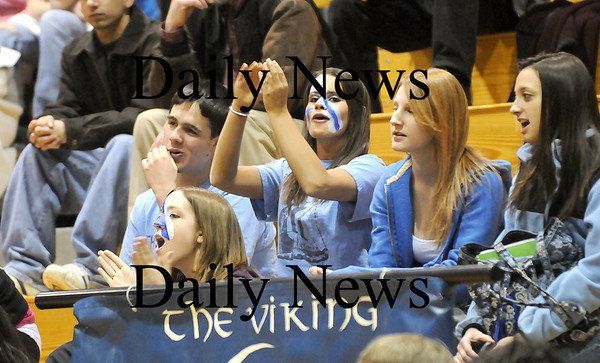 Byfield: Triton's fans showed their school spirit by cheering on the varisty boys basketball team against Amesbury Thursday night. Photo by Ben Laing/Newburyport Daily News Thursday February 5, 2009.
