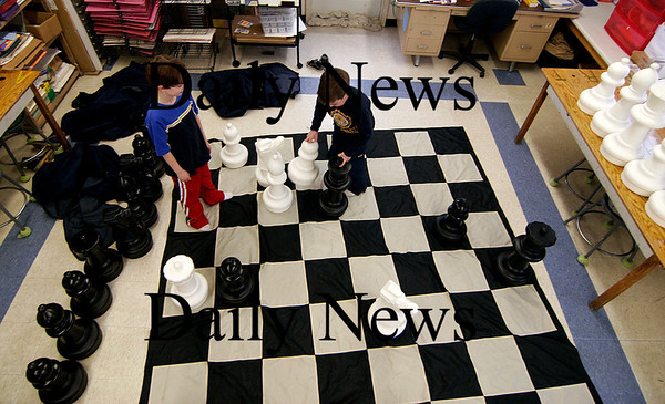Amesbury: Sam Bullis (left) and Grant Quinn (right) play a game of life size chess at Amesbury Elementary Tuesday afternoon. The pair are members of the schools chess club. Photo by Ben Laing/Newburyport Daily News Tuesday February 3, 2009.