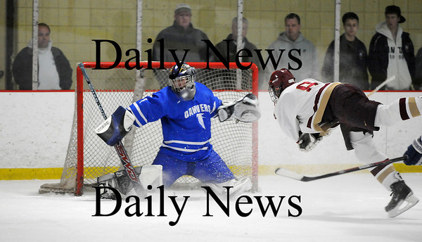 Newburyport: Newburyport's Derek Freeman (8) goes airborne for a shot on Danvers goalie Mike Allain (1) during the Clippers 6-0 victory Friday night. Photo by Ben Laing/Newburyport Daily News Friday February 20, 2009.