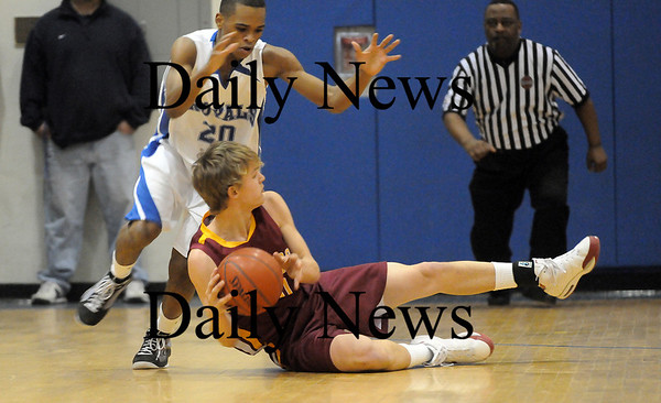 Georgetown: Newburyport's Kyle Uhlig (10) looks for an open teammate after stealing the ball from Georgetown's Jaymie Spears (20) during Monday's game in Georgetown. Photo by Ben Laing/Newburyport Daily News Monday February 16, 2009.