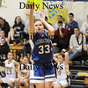 Lynnfield: Georgetown's Taryn O'Connell (33) takes a three pointer during Monday night's game at Lynnfield.  Photo by Ben Laing/Newburyport Daily News Monday February 2, 2009.