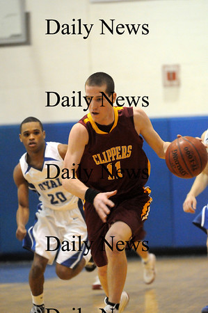 Georgetown: Newburyport's Joe Clancy (11) brings the ball up the court during Monday's game against Georgetown. Photo by Ben Laing/Newburyport Daily News Monday February 16, 2009.