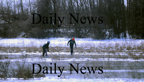West Newbury: A pair of yougsters skate around on a frozen field off of Turkey Hill Road in West Newbury Monday morning. Photo by Ben Laing/Newburyport Daily News Monday February 16, 2009.